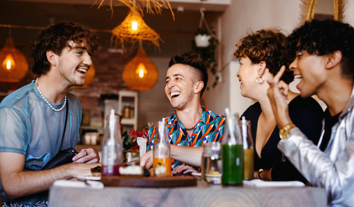 Laughing friends in a restaurant