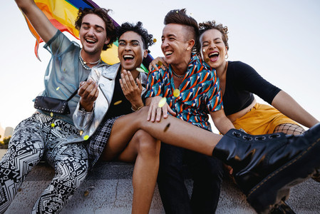 Young people celebrating gay pride outdoors