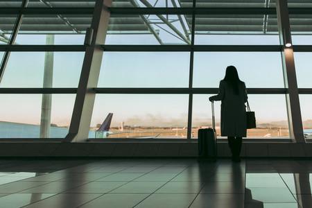 Lady waiting at airport terminal