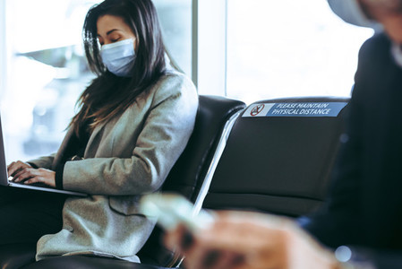 Businesswoman sitting at airport
