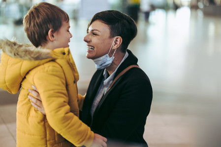 Woman meeting her son at airport