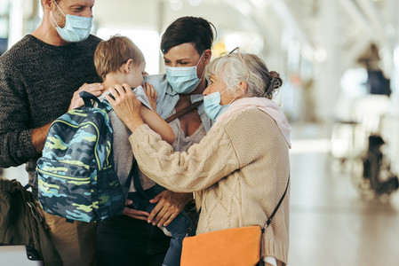 Reunion of family at airport post pandemic