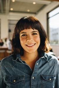 Portrait of happy female entrepreneur