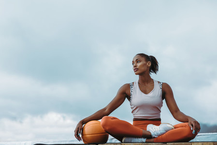 Fitness woman resting after workout on rooftop