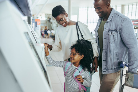 Family doing self check in at airport