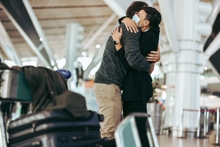 Wife receiving and welcoming her husband at airport