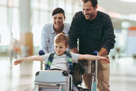 Family enjoying while waiting at airport