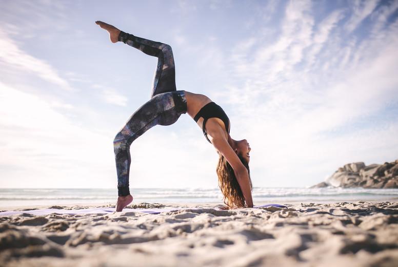 Fitness female in eka pada urdhva dhanurasana