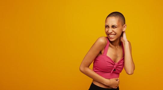 Stylish female model on yellow background