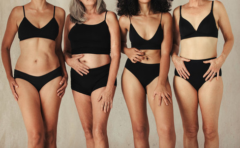 Female bodies of all ages wearing black underwear