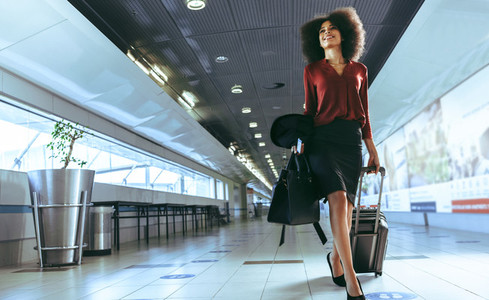 Woman going to airport terminal