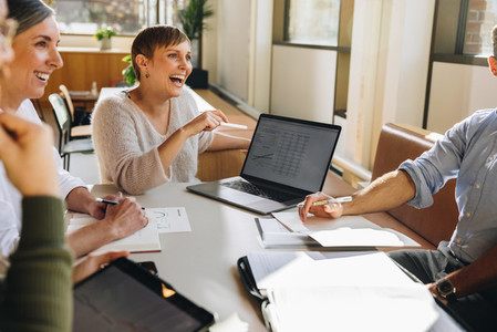 Smiling businesswoman in project discussion