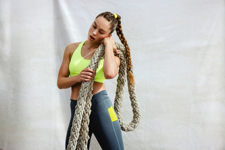 Woman relaxing after intense cross training session