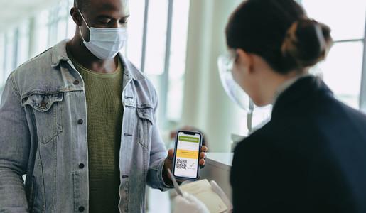 Man using vaccine passport to travel during pandemic