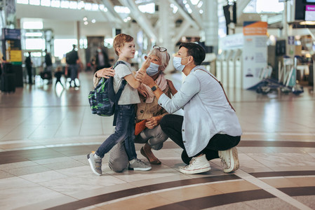 Family traveling by air waiting at airport during pandemic