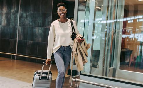 African female traveler at airport