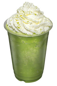 Green Tea Smoothies mixed with whip cream topping on top isolate