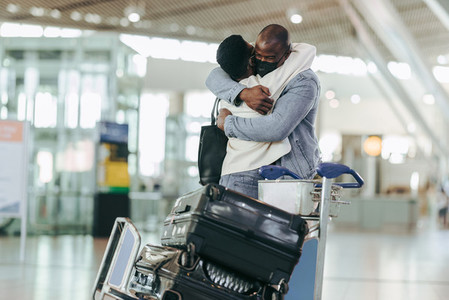 Separated couple meeting at airport terminal