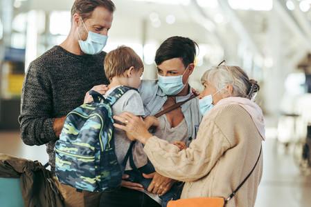 Grandma meeting family at airport post pandemic