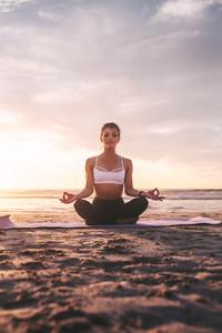 Woman meditating in lotus pose