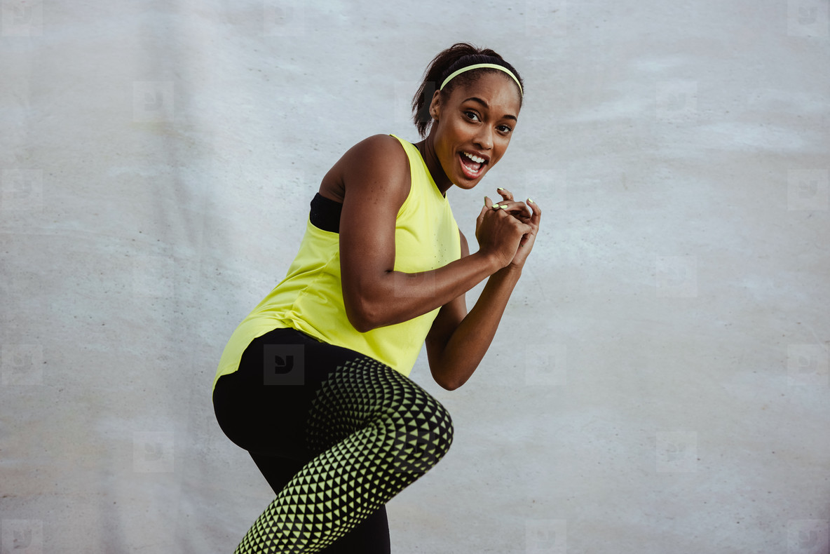 African fitness woman doing kick boxing workout