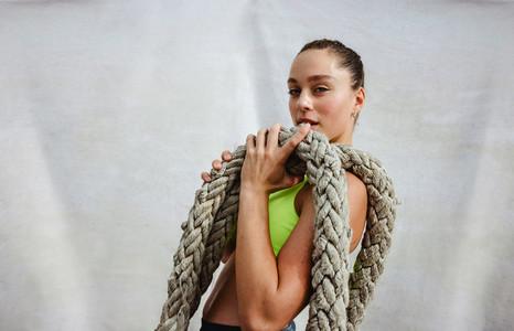 Sportswoman with battle rope
