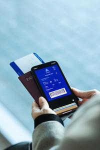 Passenger holding digital pass