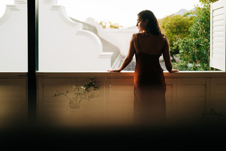 Tourist woman standing outside her hotel room