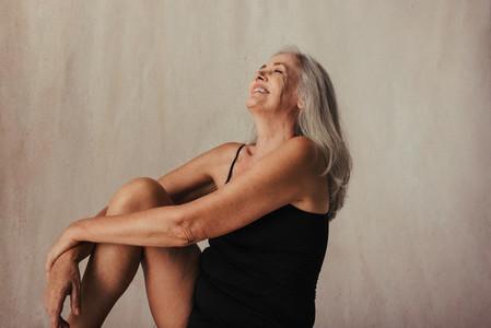 Beautiful aging woman celebrating her body