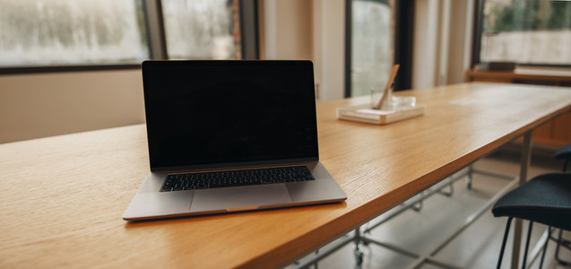 Blank laptop background in coworking space