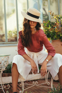 Stylish young woman posing in a summer hat