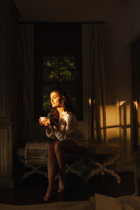 Young woman relaxing in her hotel room