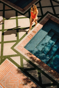 High angle view of a tourist woman going for a swim at a spa res