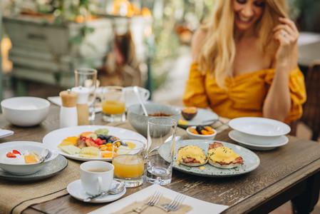 Tourist woman enjoying breakfast at a holiday resort