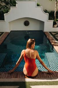 Sunbathing in a red swimsuit