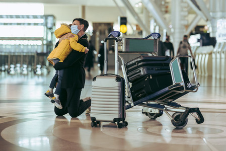 Mother and son at airport during pandemic