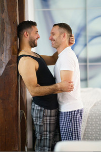 Gay couple laughing together at their home