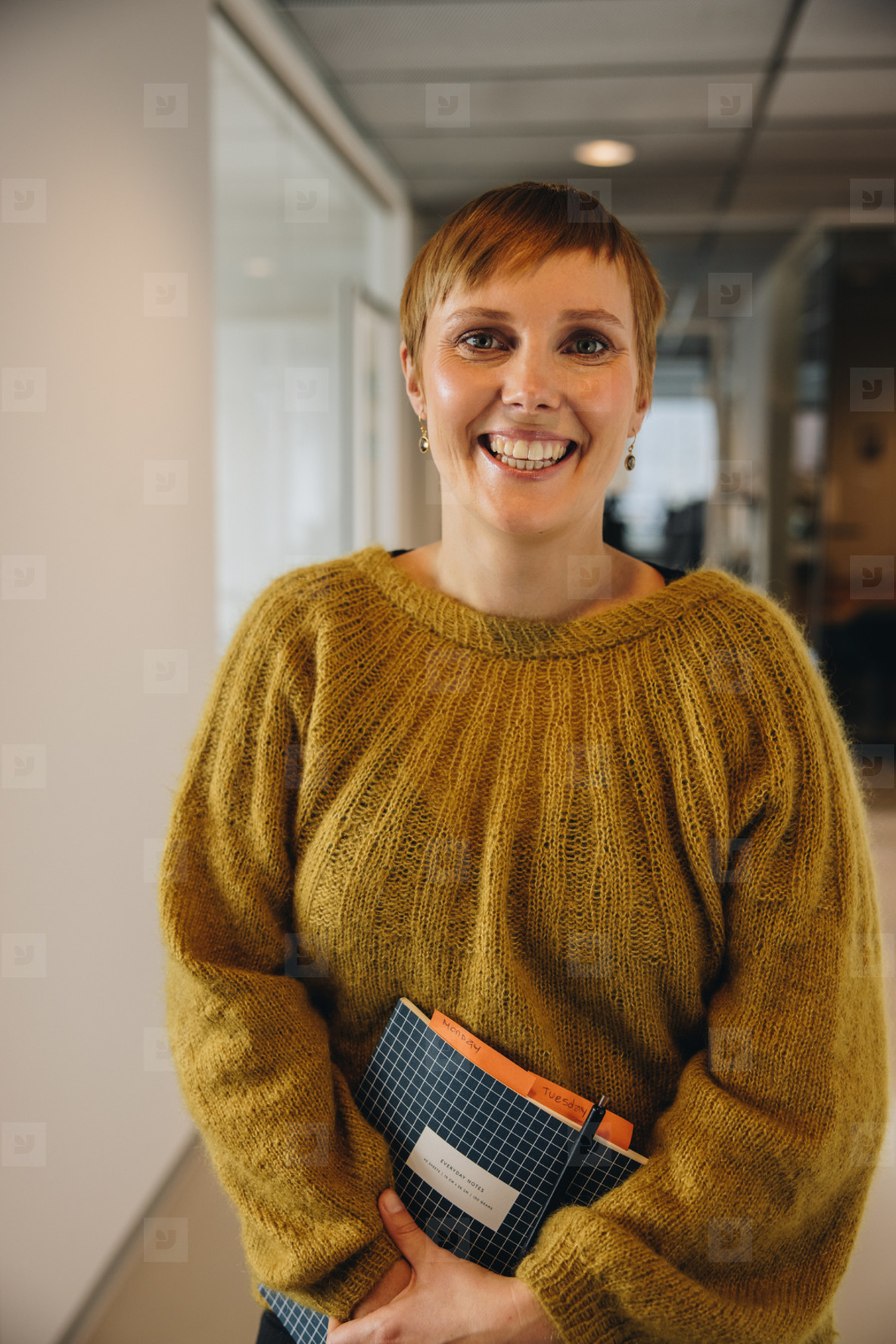 Cheerful entrepreneur standing in office