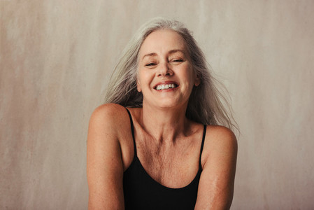 Mature woman proud of her naturally aging body