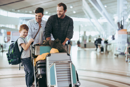 Family at airport traveling by air