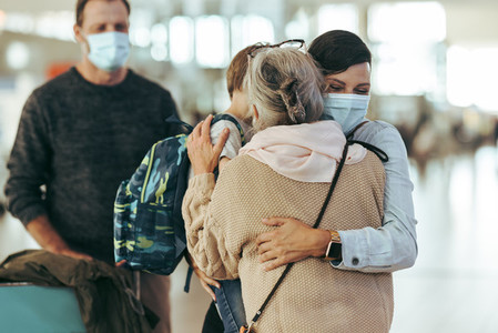 Grandma welcoming family arriving after pandemic at airport