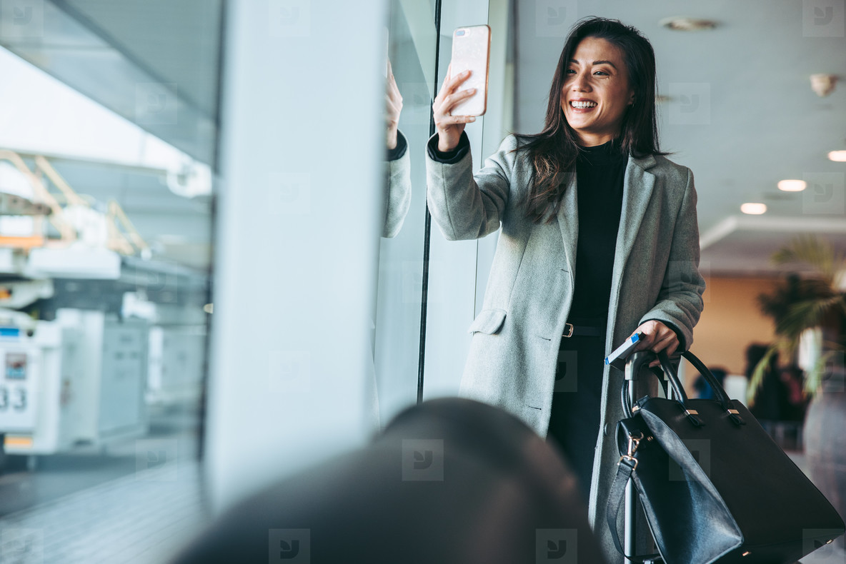 Woman in airport with phone