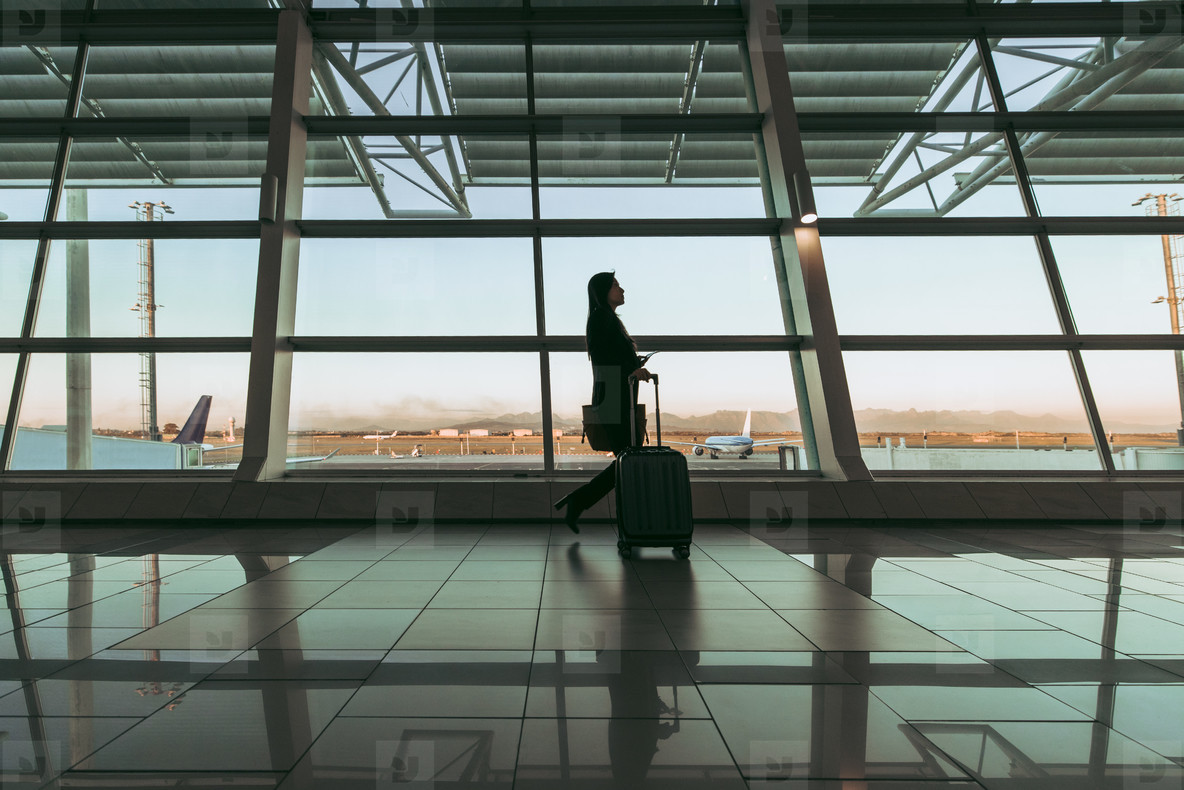 Silhouette of lady in airport