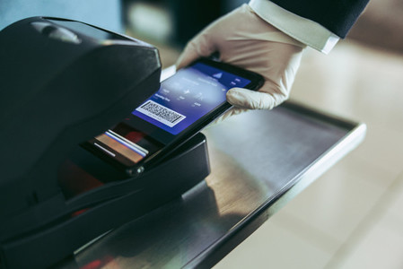 Scanning of boarding pass by airport staff