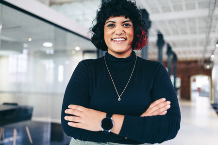 Female entrepreneur smiling in a creative office