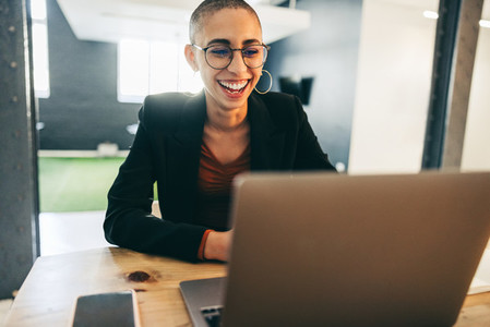Cheerful businesswoman smiling during a virtual meeting