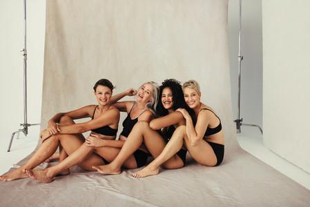 Studio shot of happy women embracing their natural bodies