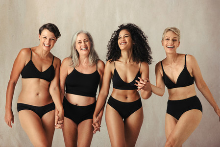Female models of different ages celebrating natural bodies