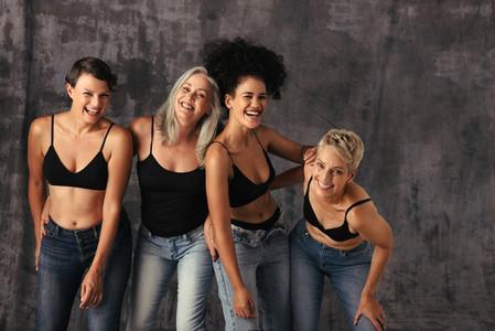 Diverse group of women having fun in jeans
