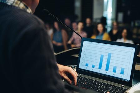Business laptop at podium in seminar